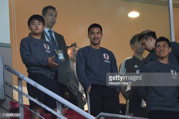 Takefusa Kubo Shinji Okazaki and Eiji Kawashima of Japan look on prior to the international friendly match between Japan and Trinidad and Tobago at...
