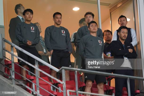 Takefusa Kubo Shinji Okazaki and other players of Japan look on prior to the international friendly match between Japan and Trinidad and Tobago at...