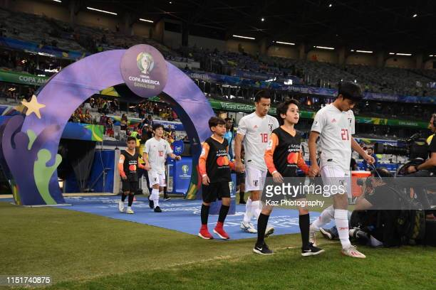 Takefusa Kubo Shinji Okazaki and Shoya Nakajima of Japan walk into the pitch during the Copa America Brazil 2019 group C match between Ecuador and...