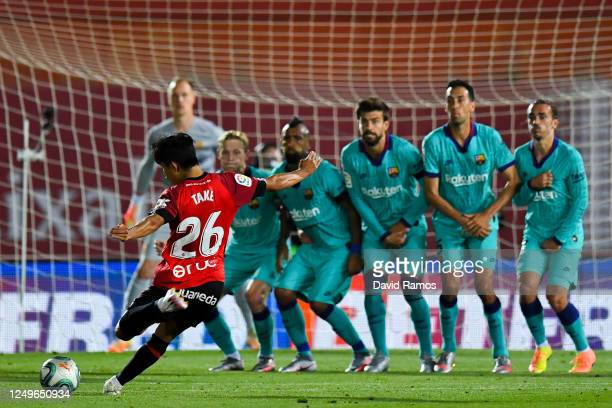 Takefusa 'Take' Kubo of RCD Mallorca takes a takes a freekick during the Liga match between RCD Mallorca and FC Barcelona at Estadio de Son Moix on...
