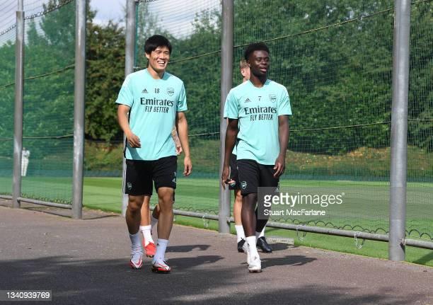 Takehiro Tomiyasu and Bukayo Saka of Arsenal during a training session at London Colney on September 17, 2021 in St Albans, England.
