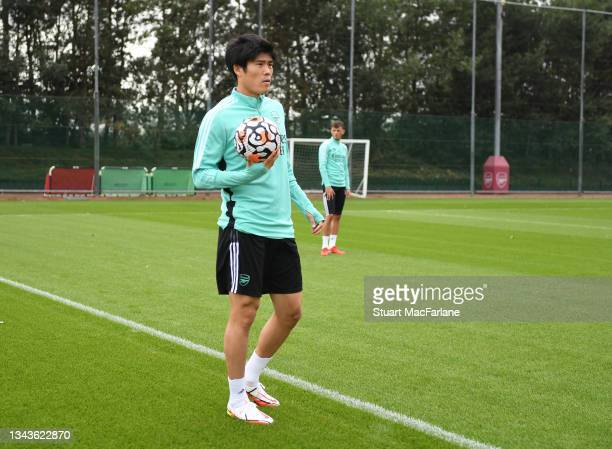 Takehiro Tomiyasu of Arsenal during a training session at London Colney on September 28, 2021 in St Albans, England.