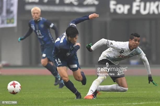 Takehiro Tomiyasu of Avispa Fukuoka and Douglas Vieira of Tokyo Verdy compete for the ball during the JLeague J1 Promotion PlayOff semi final match...