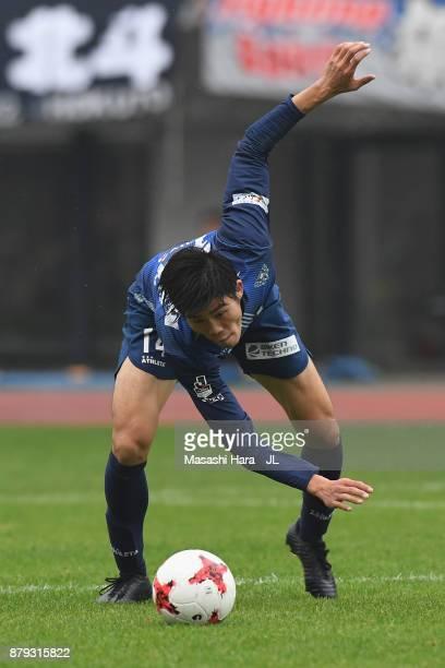 Takehiro Tomiyasu of Avispa Fukuoka in action during the JLeague J1 Promotion PlayOff semi final match between Avispa Fukuoka and Tokyo Verdy at Egao...