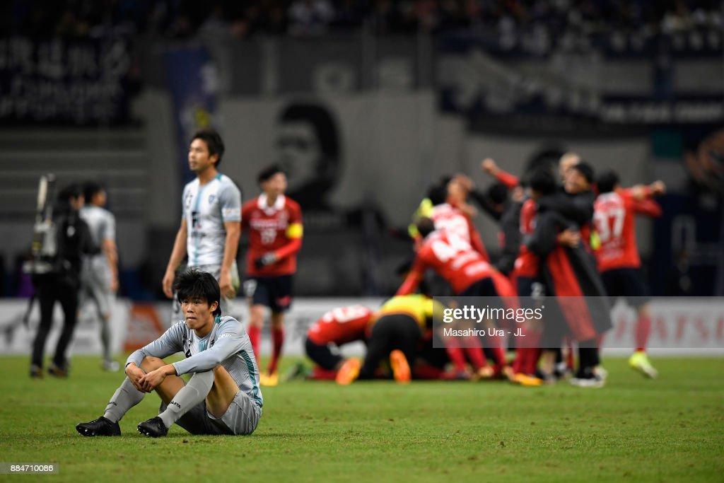 Takehiro Tomiyasu of Avispa Fukuoka shows dejection after the J.League J1 Promotion Play-Off Final between Nagoya Grampus and Avispa Fukuoka at Toyota Stadium on December 3, 2017 in Toyota, Aichi, Japan.