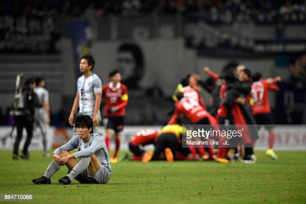Takehiro Tomiyasu of Avispa Fukuoka shows dejection after the JLeague J1 Promotion PlayOff Final between Nagoya Grampus and Avispa Fukuoka at Toyota...