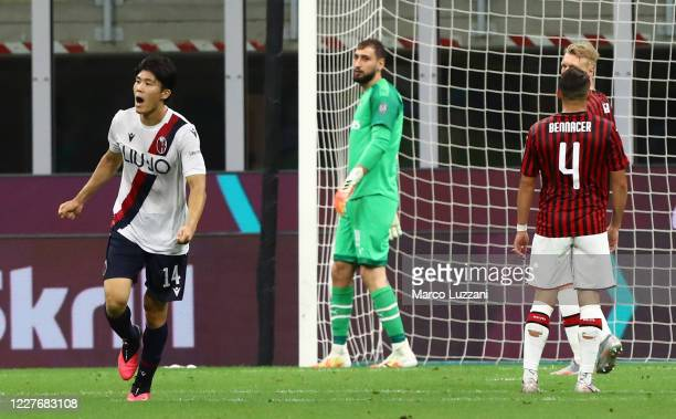 Takehiro Tomiyasu of Bologna FC celebrates his goal during the Serie A match between AC Milan and Bologna FC at Stadio Giuseppe Meazza on July 18,...