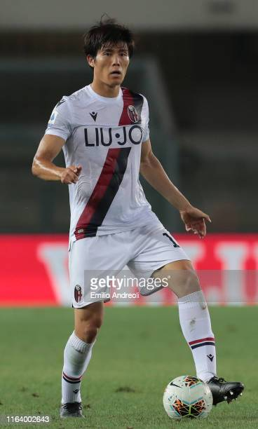 Takehiro Tomiyasu of Bologna FC in action during the Serie A match between Hellas Verona and Bologna FC at Stadio Marcantonio Bentegodi on August 25...