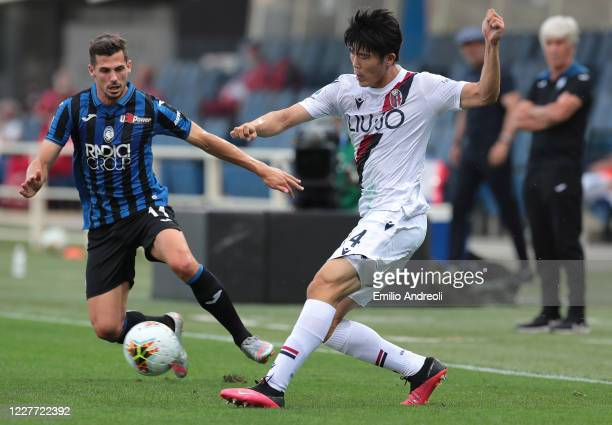 Takehiro Tomiyasu of Bologna FC is challenged by Remo Freuler of Atalanta BC during the Serie A match between Atalanta BC and Bologna FC at Gewiss...