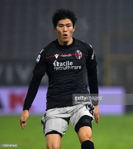 Takehiro Tomiyasu of Bologna FC looks on during the Serie A match between Spezia Calcio and Bologna FC at Stadio Alberto Picco on December 16, 2020...