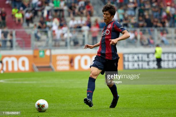 Takehiro Tomiyasu of FC Bologna controls the ball during the preseason friendly match between FC Augsburg and FC Bologna at WWKArena on August 3 2019...