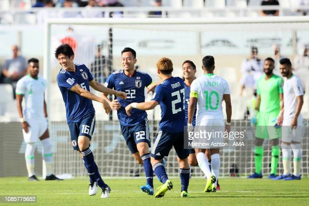 Takehiro Tomiyasu of Japan celebrates scoring a goal to make it 10 during the AFC Asian Cup round of 16 match between Japan and Saudi Arabia at...