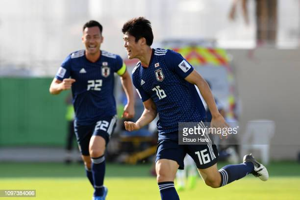 Takehiro Tomiyasu of Japan celebrates scoring his side's first goal during the AFC Asian Cup round of 16 match between Japan and Saudi Arabia at...