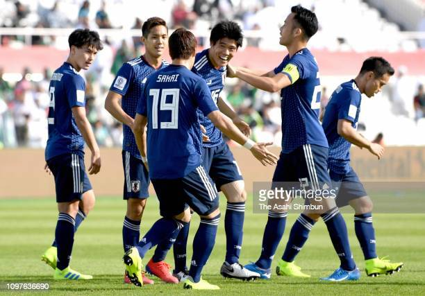Takehiro Tomiyasu of Japan celebrates scoring the opening goal with his team mates during the AFC Asian Cup round of 16 match between Japan and Saudi...