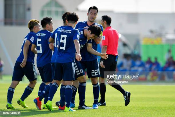 Takehiro Tomiyasu of Japan celebrates with teammates after scoring his team's first goal during the AFC Asian Cup round of 16 match between Japan and...