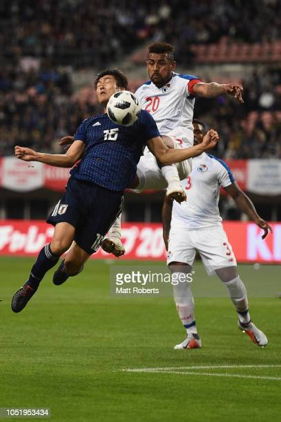 Takehiro Tomiyasu of Japan competes for the ball against Anibal Godoy of Panama during the international friendly match between Japan and Panama at...