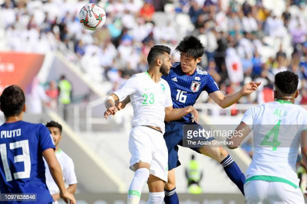 Takehiro Tomiyasu of Japan heads to score the opening goal during the AFC Asian Cup round of 16 match between Japan and Saudi Arabia at Sharjah...