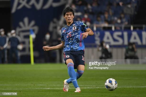 Takehiro Tomiyasu of Japan passes the ball during the FIFA World Cup Asian qualifier final round Group B match between Japan and Australia at Saitama...
