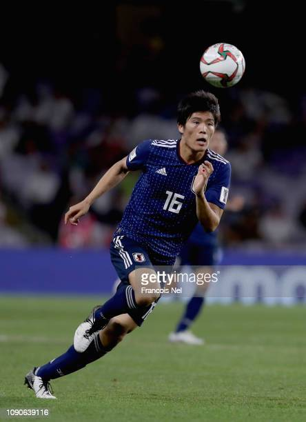 Takehiro Tomiyasu of Japan runs with the bal during the AFC Asian Cup semi final match between Iran and Japan at Hazza Bin Zayed Stadium on January...