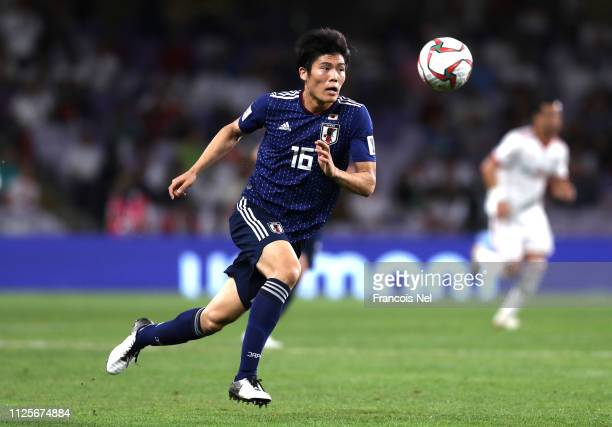 Takehiro Tomiyasu of Japan runs with the ball during the AFC Asian Cup semi final match between Iran and Japan at Hazza Bin Zayed Stadium on January...