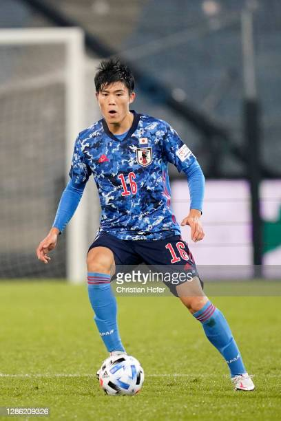 Takehiro Tomiyasu of Japan runs with the ball during the international friendly match between Japan and Mexico at Merkur Arena on November 17, 2020...