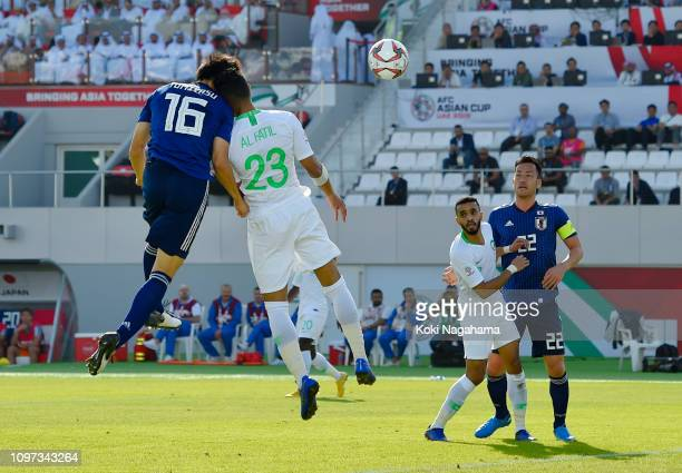 Takehiro Tomiyasu of Japan scores his team's first goal during the AFC Asian Cup round of 16 match between Japan and Saudi Arabia at Sharjah Stadium...