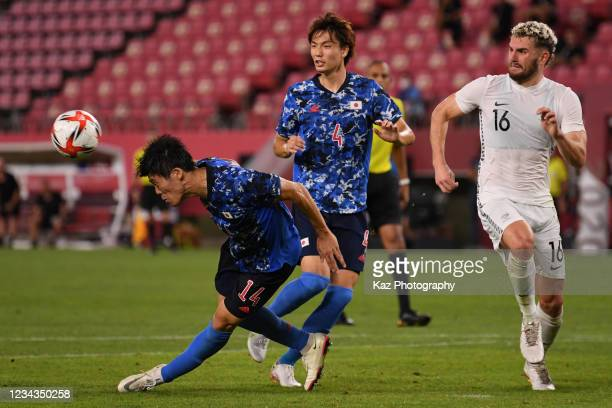 Takehiro Tomiyasu of Japan shoots the ball by head during the Men's Quarter Final match on day eight of the Tokyo 2020 Olympic Games at Kashima...