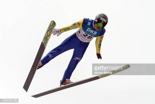Takehiro Watanabe from Japan in action during the men's final 10km jump on the large hill at the Nordic Combined World Cup in Schonach im Schwarzwald...