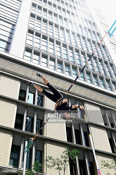 Takehito Ariki competes in the men's pole vault during the Tokyo Street Track and Field event in the Marunouchi business district May 27 2007 in...