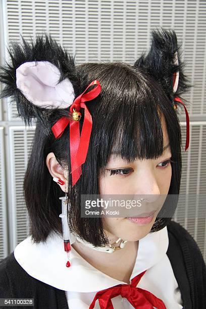 Takei Mitsuki is wearing a Bodyline lolita black dress Nemutai Company stockings black mouse ears sailor fuku schoolgirl uniform white leather star...