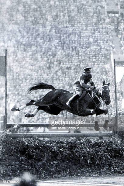 Takeichi Nishi of Japan riding Uranus competes in the Equestrian Men's Individual Jumping at the Los Angeles Memorial Coliseum on August 14, 1932 in...