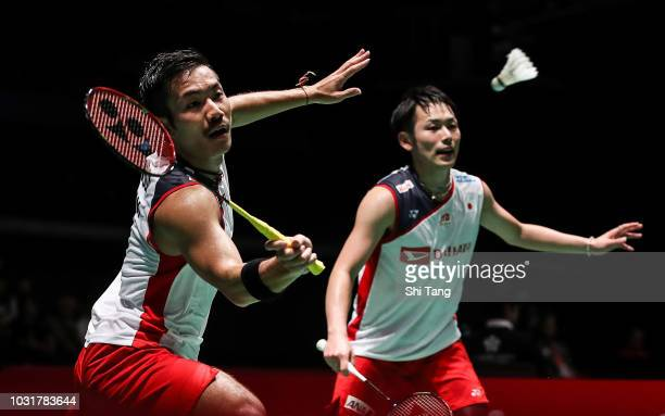 Takeishi Kamura and Keigo Sonoda of Japan competes in the Men's Doubles first round match against Satwiksairaj Rankireddy and Chirag Shetty of India...