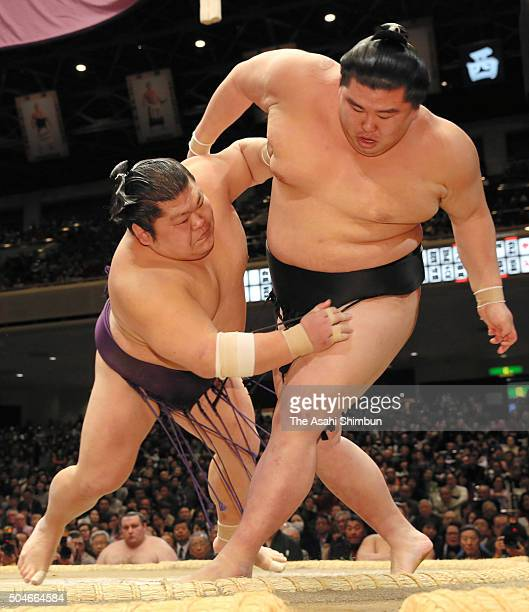Takekaze throws Shodai to win during day two of the Grand Sumo New Year Tournament at Ryogoku Kokugikan on January 11 2016 in Tokyo Japan
