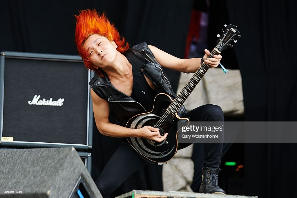 Takemura Kazuki of Crossfaith performs on stage at Download Festival at Donnington Park on June 13, 2014 in Donnington, United Kingdom.
