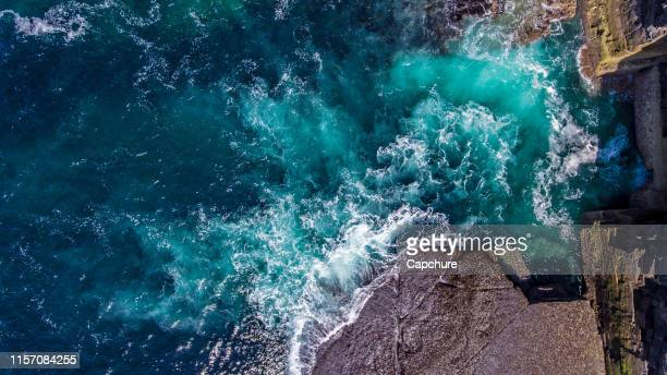 taken above the cliffs on the orkney islands in northeast scotland.  yesnaby is an area in sandwick, on the west coast of orkney mainland, scotland, south of skara brae. - rock stock pictures, royalty-free photos & images