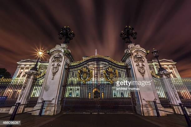 Taken at night a long exposure in front of the gates at Buckingham palace in London in a low down position as if too replicate meeting the queen and...