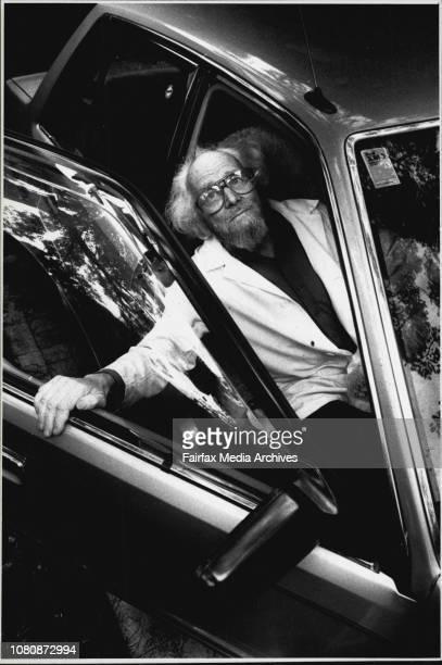 Taken at Revesby No car insurance for hail damaged carsOwner of hail damaged car Doctor Leslie Burnet with car December 21 1989