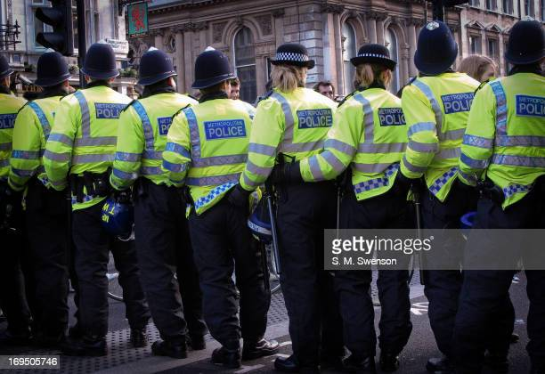 Taken at the Autumn 2010 Student Protests. Here we see police latching onto each other in an orderly line to kettle in protesters. There are both men...