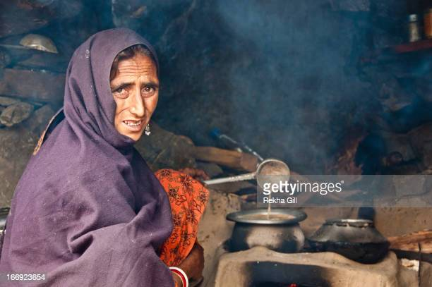 CONTENT] Taken during the trek to one of the high altitude lakes of kashmir valleyKaunsar Nag of a typical Gurjar lady making tea in hut made of...