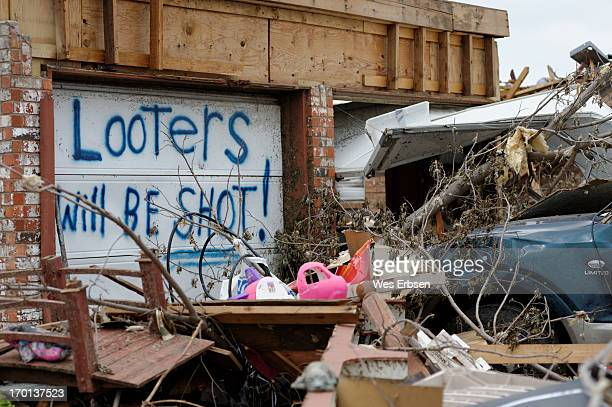 Taken following the aftermath of the tornado that swept through Moore, Oklahoma on 5-20-13. Looting has been a dreadful dilemma for the...