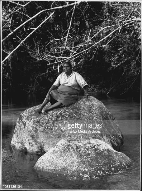 Taken in far North QueenslandThe Faces of Aboriginals and Torres Strait Islanders Hazel Douglas from Kuku yalanji people silting on a rock the...
