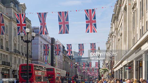 Taken in June 2012 it shows a typical London street scene during the Royal Celebrations, Union flags , Red London buses help to make the scene.