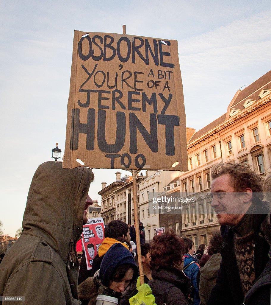 Placard against Tories Osborne and Hunt : News Photo