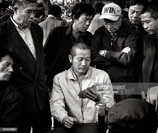 Taken on a Sunday afternoon in Jingan Park Shanghai where people relax and play cards, some of the bigger games draw a large audience , its a nice...
