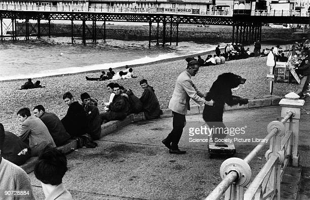 Taken on the beach at Brighton West Sussex Photographer Tony Ray Jones created most of his images of the British at work and leisure between 1966 and...