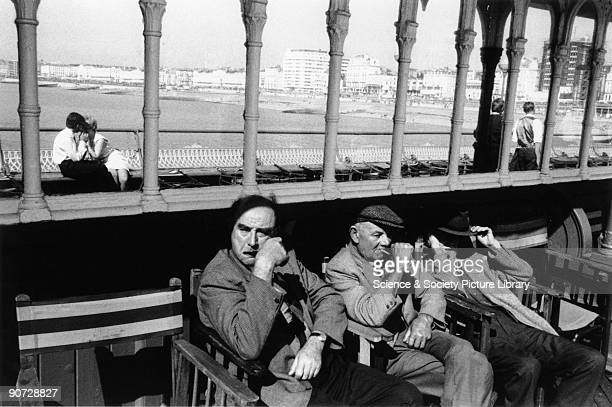 Taken on the Palace Pier at Brighton West Sussex Photographer Tony RayJones created most of his images of the British at work and leisure between...