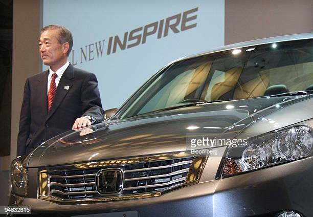 Takeo Fukui president and chief executive officer of Honda Motor Co poses with the company's Inspire sedan unveiled at a news conference in Tokyo...