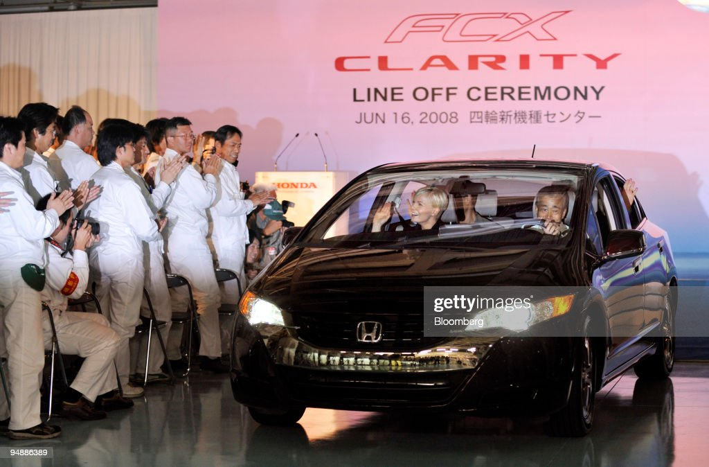 Takeo Fukui President Of Honda Motor Co Right Drives The FCX Clarity