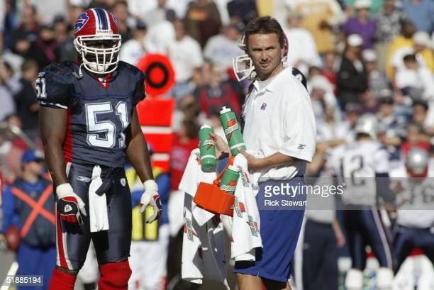 Takeo Spikes the Buffalo Bills waits for a Gatorage bottle from the trainer during the game against the New England Patriots on October 3 2004 at...