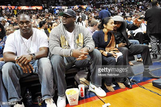 Takeo Spikes Wayne Gandy Suchita Vadlamani and G Garvin attend the Miami Heat and Atlanta Hawks playoff game 2 at Philips Arena on April 22 2009 in...